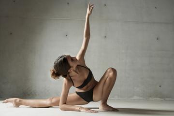 Dancer posing on floor