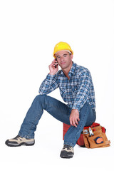 young tradesman on the phone with customer