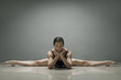 Ballet dancer posing in splits