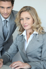 businessman and businesswoman with laptop