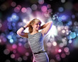 Young woman and disco background