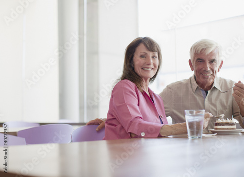 Older couple sharing dessert in cafe