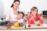 Kids cooking with their mother