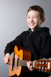 kid who plays guitar