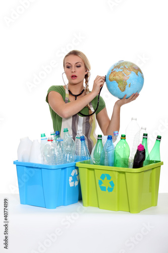 portrait of a woman with plastic bottles