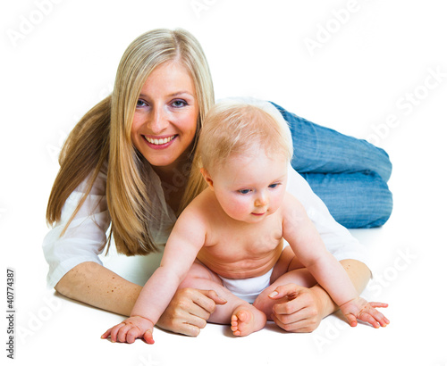 Mother holding cute infant girl isolated on white
