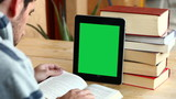 Boy studying with tablet (with green screen)