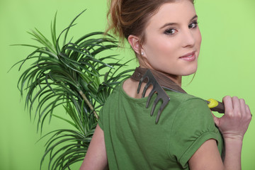 Girl with a plant and a rack