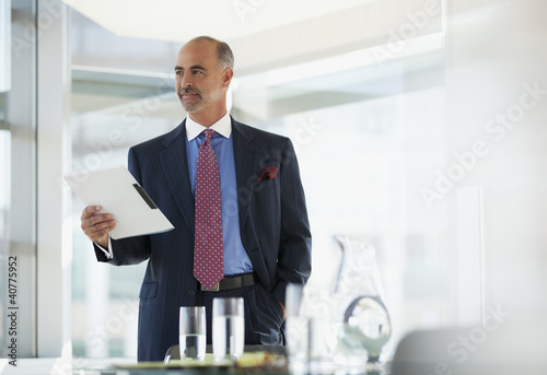 Businessman holding folder in office