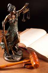 judge gavel Temida statue and law book