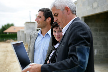 Architect and two potential clients visiting site