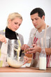 Couple preparing recipe
