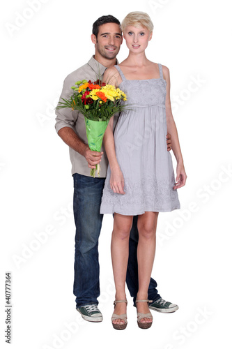 Couple with a bunch of flowers