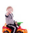 Baby boy with a big car on white background