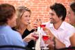 Four friends drinking in restaurant