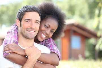 interracial couple embracing