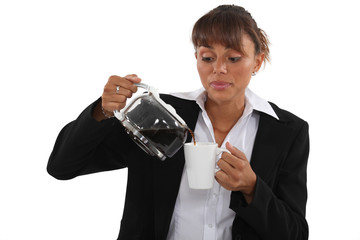 Woman pour coffee into mug