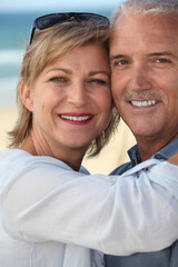 happy mature couple at beach
