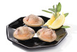 Three clams with lemon over white