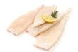 Leinwandbild Motiv Raw squid tubes with lemon and rosemary