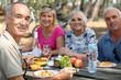 Leinwanddruck Bild - family eating picnic in the forest