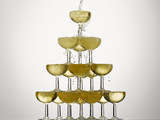 Champagne pouring into stacked glasses