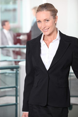 Smiling businesswoman standing in an office