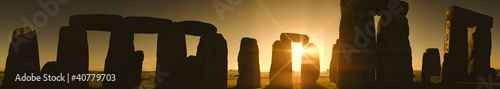 Sun rising over Stonehenge rock formation