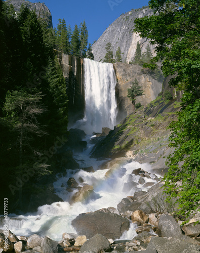 Waterfall pouring over rocky cliff
