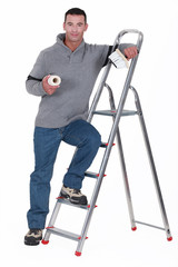Painter resting on a stepladder