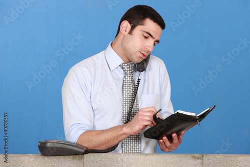 Man scheduling an appointment into his agenda