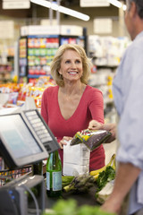 Woman buying groceries at supermarket