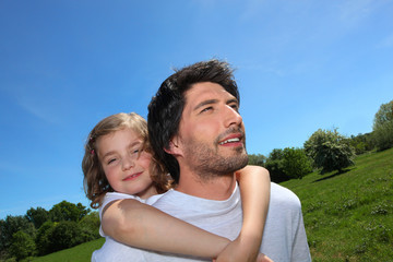Man giving daughter piggyback