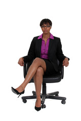 Businesswoman sat in chair