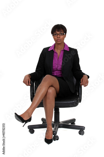Businesswoman sat in chair