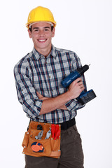 Man with a cordless screwdriver
