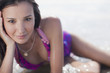 Smiling woman laying in waves at beach
