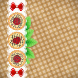 Sweet background. Cookies on a vintage checkered tablecloth.