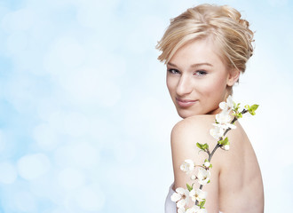 Gorgeous young blond woman with flower
