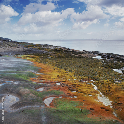 Colorful sand formations on beach