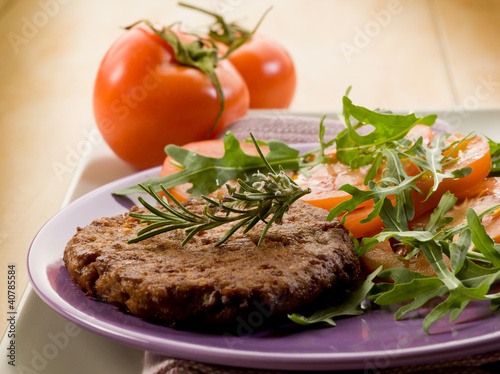 soy steak with arugua and tomatoes salad