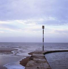 Waves washing up on stone pier