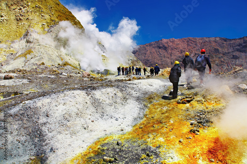 People inside active volcanic crater