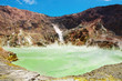 Hot acid lake in volcanic crater