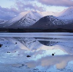 Still lake and mountains in arctic landscape