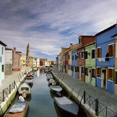 Gondolas docked in urban canal