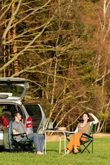 Camping car young couple relax picnic countryside