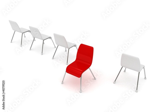 Unique red chair in row of white others