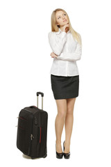 Thinking young business woman standing with suitcase
