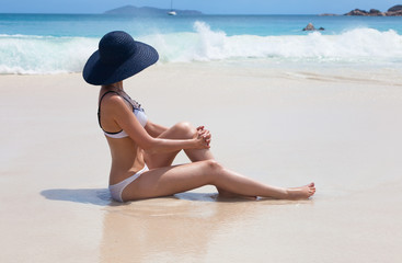 Young girl in hat on the beach
